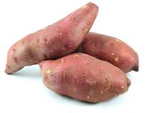 Sweet Potatoes. Three sweet potatoes on a white background Royalty Free Stock Photos