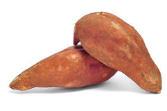 Sweet potatoes. Some sweet potatoes on a white background stock images