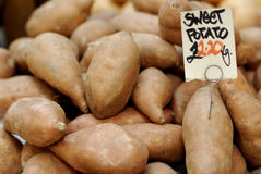 Sweet Potatoes At A Farmers Market Royalty Free Stock Photography