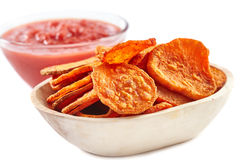 Sweet potatoes chips with tomatoes sauce Stock Photo