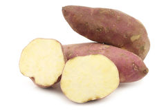 Sweet potatoes and a cut one Royalty Free Stock Photos