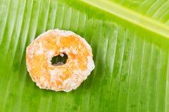 Sweet potatoes dough nut ring on banana leaf Royalty Free Stock Photo