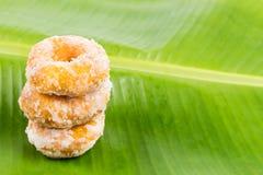 Sweet potatoes dough nut ring on banana leaf Stock Photo