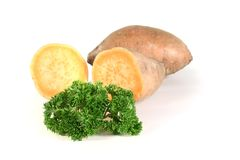 Sweet potatoes with parsley Royalty Free Stock Images