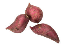 Sweet potatoes raw. On a white background. Royalty Free Stock Photo