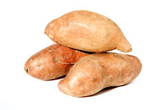 Sweet potatoes. 3 sweet potatoes on white background royalty free stock images