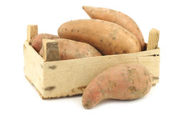 Sweet potatoes in a wooden crate Stock Photos