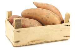 Sweet potatoes in a wooden crate Stock Image