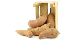 Sweet potatoes in a wooden crate Royalty Free Stock Images