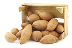 Sweet potatoes in a wooden crate Royalty Free Stock Photos