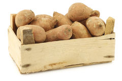 Sweet potatoes in a wooden crate Stock Images