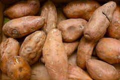 Sweet potatoes. Or yams on on an open air market fruit and vegetable stall Royalty Free Stock Images