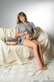 Sweet pregnancy. Beautiful pregnant woman sitting on the bed Royalty Free Stock Image