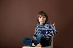 Sweet preschool boy, making faces with different emotion Royalty Free Stock Photo