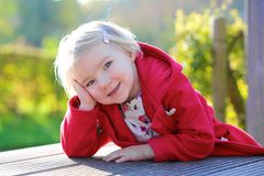 Sweet preschooler girl in the park Stock Photos