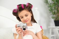 Girl playing with camera. Stock Image