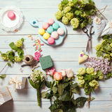 Sweet present. Sweet macarons and flowers - preparation of present Stock Photography