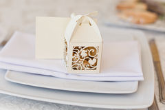 Sweet presents to guests. A small nice present. Bonbonniere. Beautiful cute little boxes with decorative cut for candies Stock Images