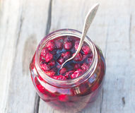 Sweet preserve of red berry and spoon Stock Image