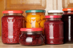 Sweet preserves. As jams and compotes on table in kitchen Royalty Free Stock Photography