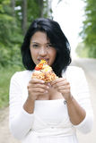 Sweet and pretty girl eating pizza Royalty Free Stock Image