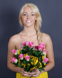Sweet, Pretty Woman Holding Flowers Royalty Free Stock Photos