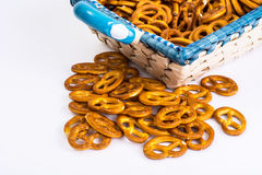 Sweet pretzels on a beautiful fabric in a wicker basket on a white background royalty free stock image