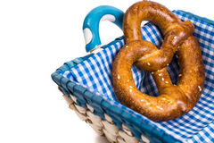 Sweet pretzels on a beautiful fabric in a wicker basket on a white background stock photos
