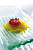 Sweet Pudding. View of a colorful dessert fruit pudding placed in a striated glass plate Stock Image