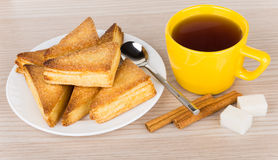 Sweet puff pastries in glass plate and tea in cup Royalty Free Stock Photos