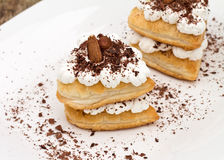 Sweet puff pastry. With cream, chocolate and dried fruit Stock Photography