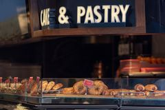 Sweet puff pastry at a pastry shop display stock images