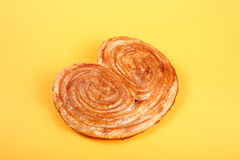 Sweet puff pastry on yellow background - Palmeras Royalty Free Stock Photography