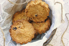 Sweet pumpkin cakes with raisin. Homemade rustic muffins with pumpkin and oatmeal on bowl with white greaseproof paper Stock Images