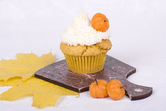Sweet pumpkin muffin with marzipan pumpkins Stock Image