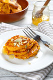 Sweet pumpkin pancakes on a plate Royalty Free Stock Images