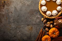 Pumpkin pie with whipped cream. Sweet pumpkin pie decorated with whipped cream overhead shot with copy space stock photo