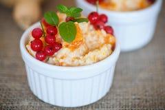 Sweet pumpkin porridge with berries Stock Image