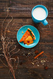 Sweet pumpkin tart with cup of milk flat lay. Sweet orange pumpkin tart with bright turquoise cup of milk flat lay. Top view on pretty served sweet dessert with Stock Photos