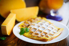 Sweet pumpkin waffles on the plate Stock Photography