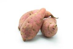 Sweet purple fresh potato on white Royalty Free Stock Images