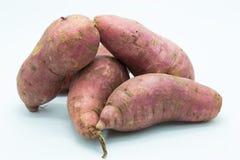 Sweet purple potato on white background Royalty Free Stock Image