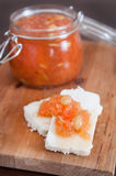 Sweet quince jam with almonds on white cheese. Selective focus Stock Images