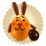 Sweet rabbit congtatulations. Smiling rabbit with chocolate egg over beige dotted round background  - holiday greetings decorative postcard Royalty Free Stock Image