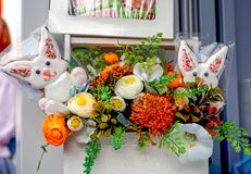 Sweet rabbits in flower arrangement street store royalty free stock images
