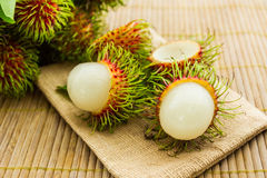 Sweet Rambutan fruit with leaves. Royalty Free Stock Images