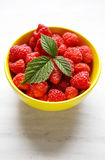 Sweet raspberries in bowl on table. Close up, top view, high res Royalty Free Stock Photo