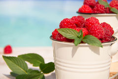 Sweet raspberries in bowl on wooden table. Close up, top view Royalty Free Stock Images