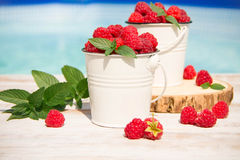 Sweet raspberries in bowl on wooden table. Close up, top view Stock Photography