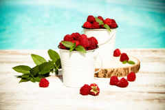 Sweet raspberries in bowl on wooden table. Close up, top view Royalty Free Stock Photos
